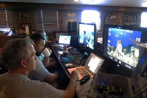 The ROV operations center with National Geographic photographer Brian Skerry on the left, Lew Lamar (Camera Technician) and Steve Firman (ROV pilot)